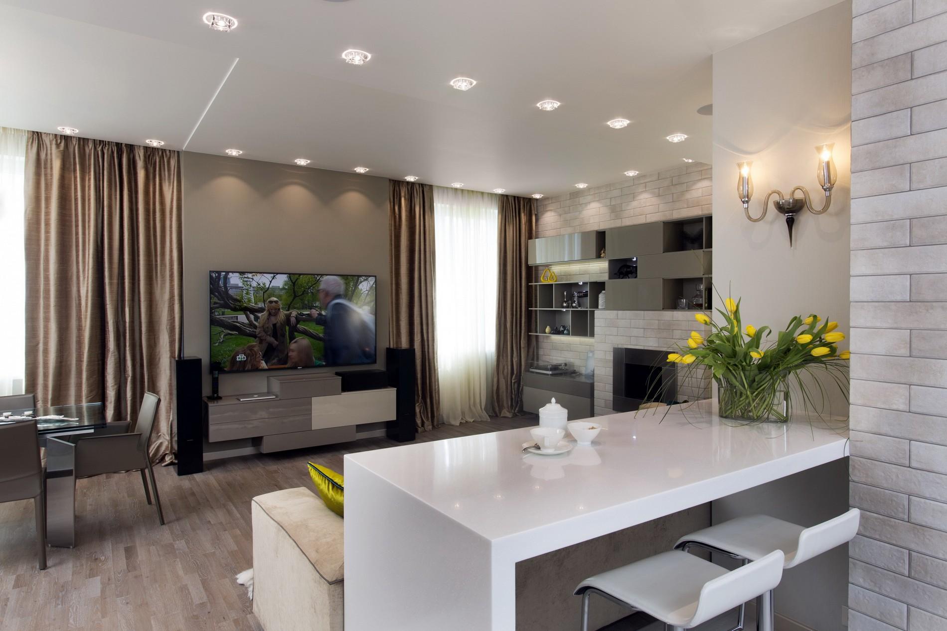 Кухня с белой барной стойкой в современном стиле